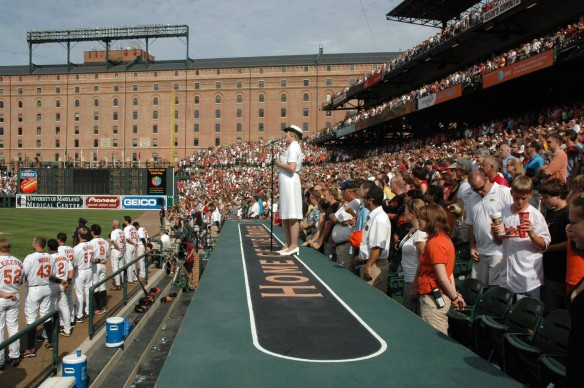070909-N-0303C-002 BALTIMORE (Sept. 9th, 2007) - Musician 1st Class Beth E. Revell sings ÒGod Bless America,Ó during the seventh inning stretch between the Baltimore Orioles and the Boston Red Sox at Camden Yards. U.S. Navy photo by Musician 1st Class Tina M. Catalanotto (RELEASED)